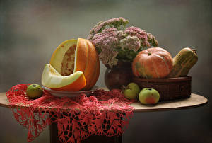 Фотография Натюрморт Тыква Яблоки Дыни Стол Корзина Продукты питания
