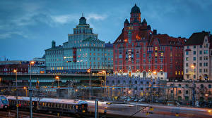 Картинки Швеция Стокгольм Дома Мосты Поезда Вечер Уличные фонари