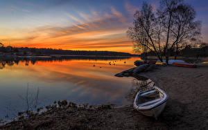 Фотография Швеция Рассветы и закаты Берег Лодки Речка Природа