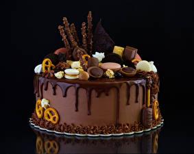 Фотографии Сладости Торты Шоколад Печенье На черном фоне Дизайн Продукты питания