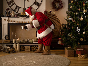 Картинки Рождество Свечи Санта-Клаус Елка Подарки Камин
