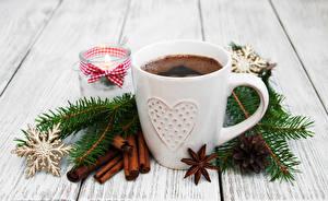 Картинки Рождество Кофе Корица Доски Чашка Ветки Снежинки Шишки Еда