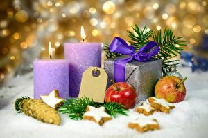 Фотография Рождество Печенье Свечи Яблоки Подарки Снег