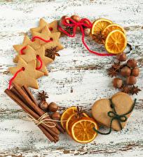 Картинки Рождество Печенье Корица Орехи Бадьян звезда аниса Апельсин