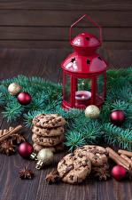 Картинка Рождество Печенье Бадьян звезда аниса Свечи Ветвь Фонарь Шар Пища