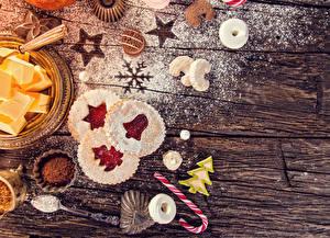 Фотография Новый год Мука Печенье Сладости Доски Дизайн Какао порошок Продукты питания