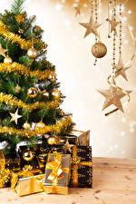 Фотографии Новый год Праздники Елка Подарки Шар