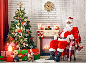 Картинки Рождество Праздники Плюшевый мишка Свечи Часы Новогодняя ёлка Подарки Санта-Клаус Сидящие