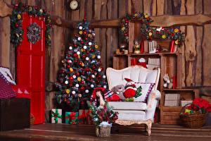 Картинка Рождество Праздники Стена Елка Кресло Подарки Корзина