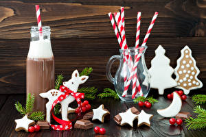 Фотографии Новый год Горячий шоколад Печенье Сладости Шоколад Олени Бутылка Кувшин Звездочки Продукты питания