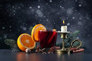 Фотография Рождество Апельсин Напитки Бадьян звезда аниса Корица Орехи Свечи Стакан Пища