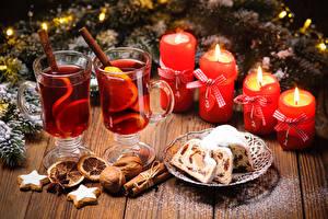 Фото Рождество Кекс Орехи Корица Свечи Напитки Печенье Доски Стакан