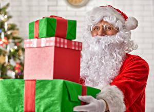 Обои Рождество Санта-Клаус Подарки Борода