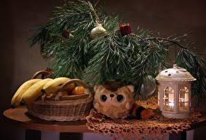 Фото Новый год Натюрморт Бананы Свечи Ветки Корзинка