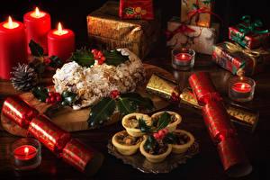Фотографии Рождество Натюрморт Выпечка Свечи Подарки Еда