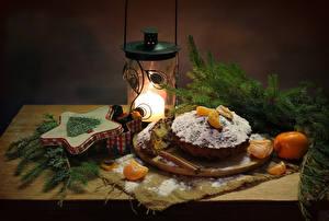 Фотография Новый год Натюрморт Выпечка Кекс Мандарины Корица Свечи Ветвь Еда