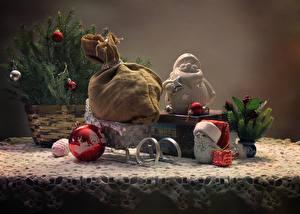 Фото Новый год Натюрморт Сани Ветки Подарки Шарики