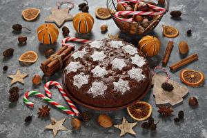 Фотография Новый год Сладости Торты Корица Бадьян звезда аниса Орехи Мандарины Дизайна Еда