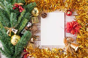 Фотографии Рождество Шаблон поздравительной открытки Ветки Шарики Колокольчики Шишки