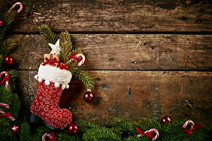Фотография Рождество Доски Ветки Сапоги Шарики Подарки
