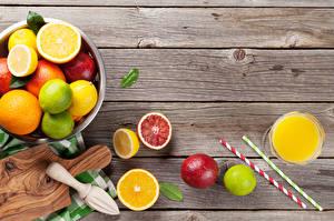 Фото Цитрусовые Лимоны Грейпфрут Сок Доски Разделочная доска Стакан Еда