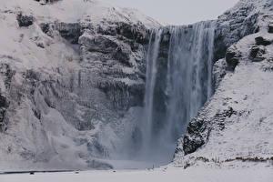 Фотография Исландия Зима Водопады Снег Скала