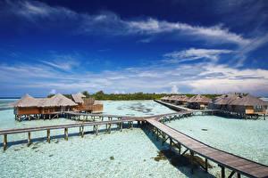 Картинки Мальдивы Тропики Море Мосты Небо Бунгало Lankanfushi Island