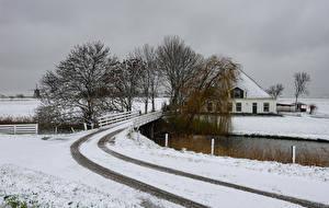 Картинки Голландия Зимние Здания Река Мост Снега Природа