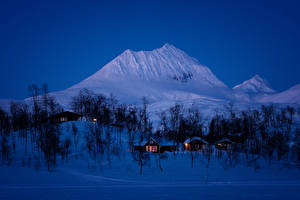 Картинка Норвегия Горы Зима Вечер Снега Дерево Природа