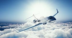 Фотографии Самолеты Пассажирские Самолеты Летят Облако Learjet 45 Авиация