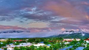 Обои Австралия Здания Небо Туман Холмы Cairns Queensland Города