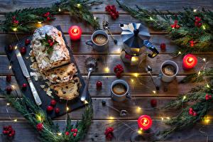 Картинка Рождество Выпечка Кекс Свечи Кофе Чайник Ягоды Изюм Доски Ветвь Чашка Ложка Пища