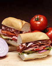 Фотографии Фастфуд Сэндвич Мясные продукты Овощи Хлеб Пища
