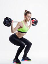 Фото Фитнес Белый фон Шатенка Штанга Физические упражнения Девушки Спорт