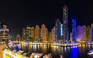 Картинки Дома Небоскребы Дубай Объединённые Арабские Эмираты В ночи Водный канал Города