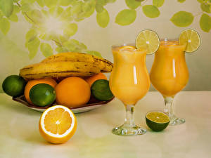 Обои Сок Бананы Лимоны Апельсин Бокалы Пища