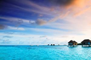 Картинки Мальдивы Тропики Море Небо Бунгало