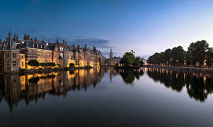 Картинки Нидерланды Здания Вечер Водный канал Hague Города