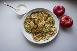 Картинки Блины Помидоры Тарелка Продукты питания