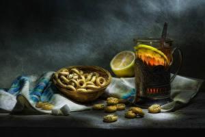 Фотография Натюрморт Чай Выпечка Лимоны Стакан Еда