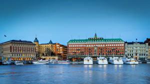 Обои Швеция Стокгольм Дома Реки Пирсы Речные суда