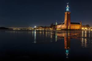 Картинки Швеция Стокгольм Дома Реки Ночные Отражение Города