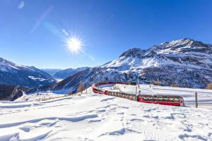Обои Швейцария Горы Зимние Поезда Альпы Снег Солнце Graubunden