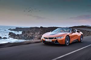Фото BMW Оранжевый Едущий Родстер 2018 i8 Машины