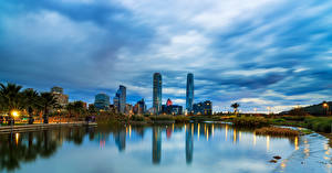 Фото Чили Сантьяго Здания Реки Вечер Небо Города