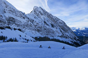 Обои Франция Зимние Горы Альпы Снег Велосипед Втроем