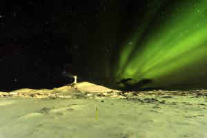 Фотография Исландия Маяки Небо Звезды Полярное сияние Ночь Снеге