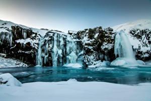 Фотография Исландия Зимние Водопады Утес Снег Лед Природа