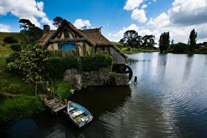 Картинка Новая Зеландия Парки Пруд Дома Лодки Matamata Hobbiton Природа