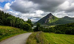 Картинки Норвегия Лофотенские острова Горы Лес Дороги Облако Природа